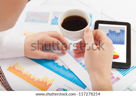 Businessman relaxing during coffee break at workplace - stock photo