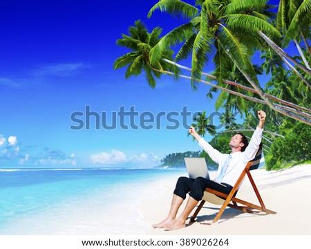 Businessman Relaxing Idyllic Palm Fringed Beach Concept - stock photo