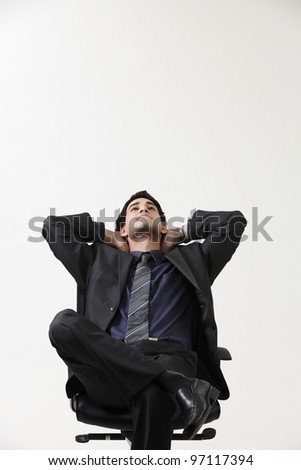 Businessman relaxing in black chair