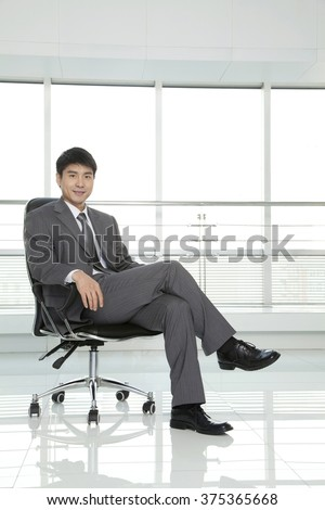 Businessman Relaxing in Chair - stock photo