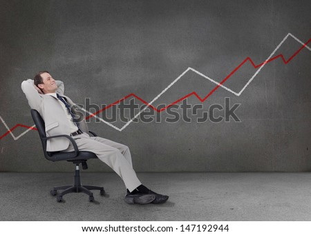 Businessman relaxing on a chair with white and red chart on the background - stock photo