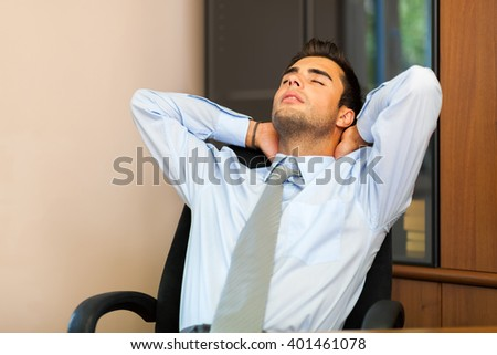Businessman relaxing on his chair after an hard working day - stock photo