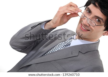 Businessman removing glasses - stock photo