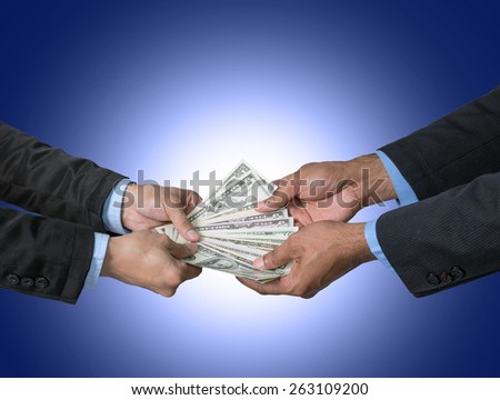 Businessman rereiving the money offered by businessman on dark blue background,include clipping path - stock photo