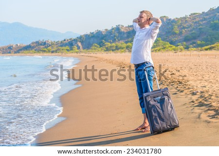 businessman rest on the island with a suitcase - stock photo