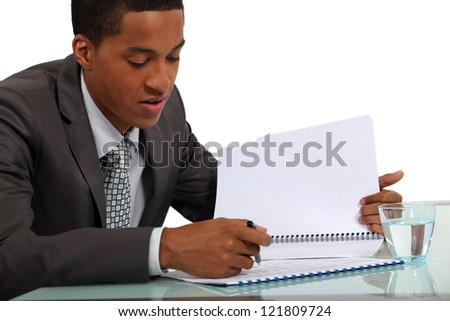Businessman reviewing a report - stock photo