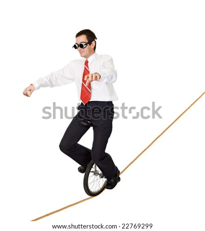Businessman riding on mono cycle on a rope - concept for reckless business and risk taking - isolated - stock photo