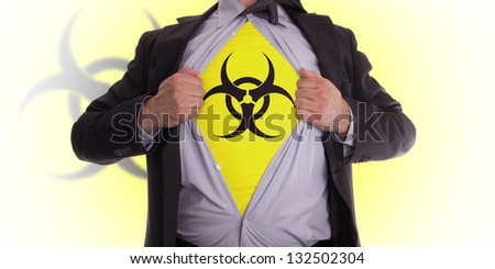 Businessman rips open his shirt to show his biohazard symbol t-shirt - stock photo