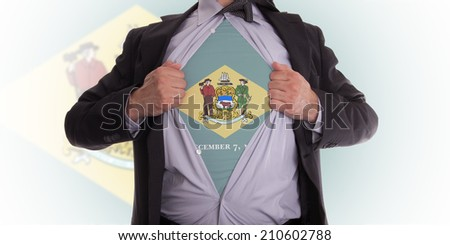 Businessman rips open his shirt to show his Delaware flag t-shirt - stock photo