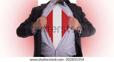 Businessman rips open his shirt to show his peru flag t-shirt - stock photo