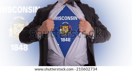 Businessman rips open his shirt to show his Wisconsin flag t-shirt - stock photo