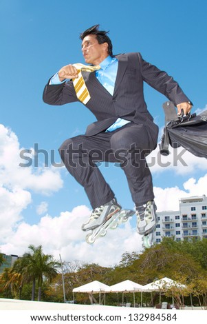 Businessman rollerblading with briefcase in urgency with cloudy sky in background. Vertical shot. - stock photo