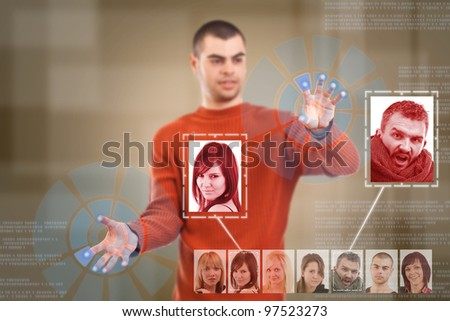 Businessman rotate high tech type of modern buttons on a virtual background - stock photo