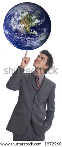 Businessman rules the world - stock photo