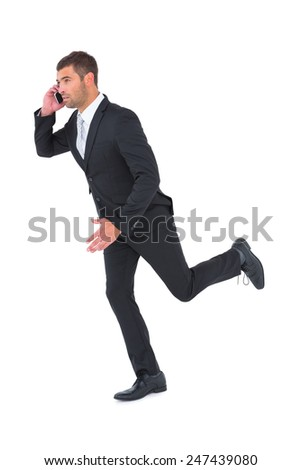 Businessman runing on the phone on white background