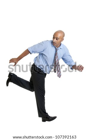 Businessman running against a white background