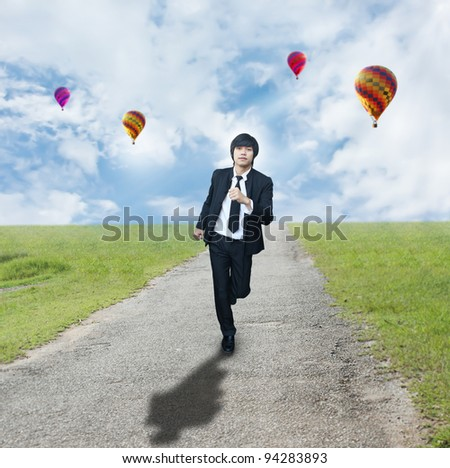Businessman running on rough roads - stock photo