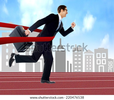 Businessman running on track, cityscape background - stock photo