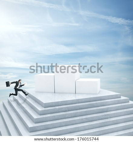 Businessman running to highest cube - stock photo