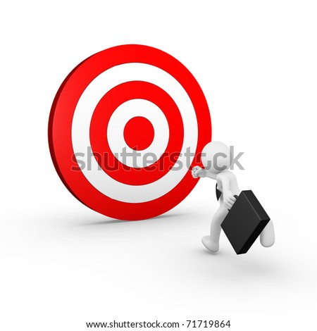 Businessman running towards a target - stock photo
