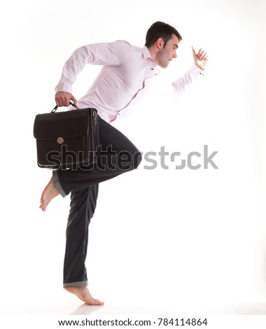 Businessman running with a briefcase, isolated on white background