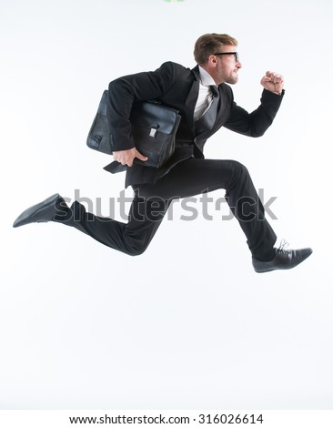 Businessman running with a briefcase isolated on white background. Successful man in glasses is in a hurry. - stock photo
