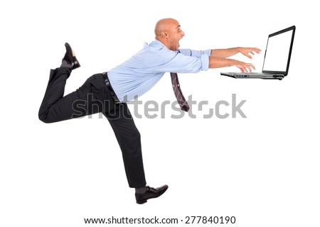 Businessman running with raised arms chasing a laptop, isolated in white - stock photo