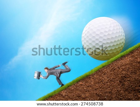 Businessman runs from problems - stock photo