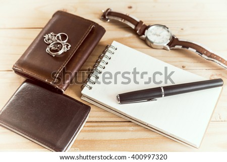 Businessman's accessories, notepaper, pen, wristwatch, wallet-vintage style - stock photo