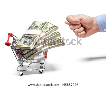businessman's fig & steel grocery cart full of money stacks / man's hand shows the fig to a cart full of money stacks - isolated on white background
