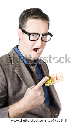 Businessman's Finger With Coin Caught In Mousetrap - stock photo