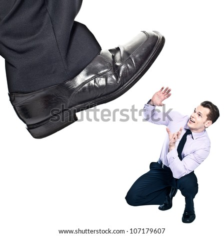 Businessman's foot stepping on tiny businessman - unequal competition concept