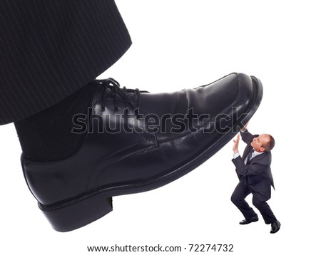 Businessman's foot stepping on tiny businessman-unequal competition concept - stock photo