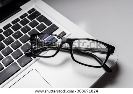 Businessman's glasses on laptop computer
