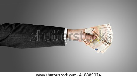 Businessman's hand holding a stack of fifty euro notes isolated on white background. - stock photo