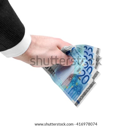 Businessman's hand holding a stack of twenty euro notes isolated on white background. - stock photo