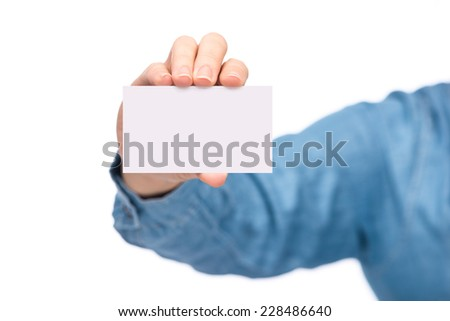 businessman's hand holding blank white paper business card