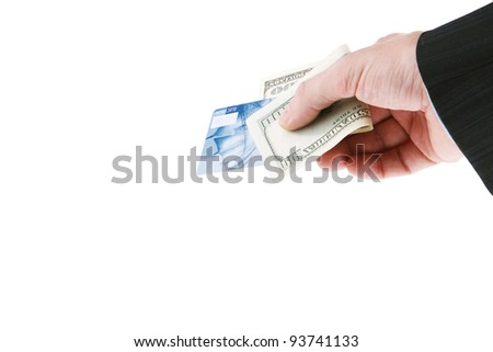 Businessman's hand holding one hundred dollars and blue credit cards. Isolated on white background - stock photo