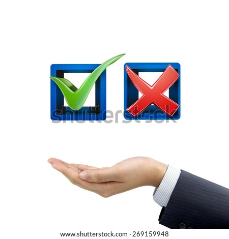 businessman's hand holding red and green check mark icons over white background - stock photo