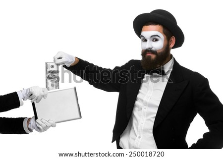 businessman's hand in the form of mime extract money from tablet PC, isolated on white - stock photo