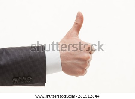 Businessman's hand showing thumd up sign, white background