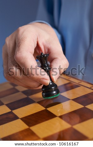 businessman's hand  with chess - stock photo