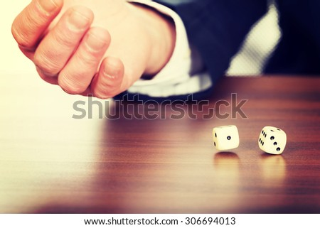 Businessman's hand with two dices.