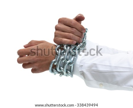 Businessman's hands chained together tightly - stock photo