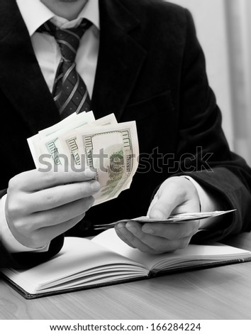 Businessman's hands counting dollars