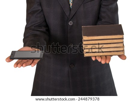 Businessman's hands offering choice between obsolete books or smartphone isolated - stock photo
