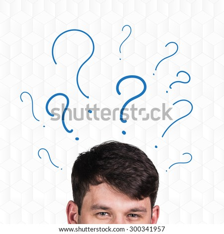 Businessman's head with question marks on a white background