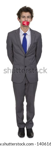 Businessman's Mouth Covered With Adhesive Tape Over White Background - stock photo