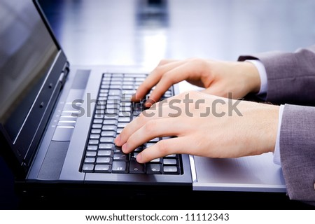 Businessman's typing on laptop