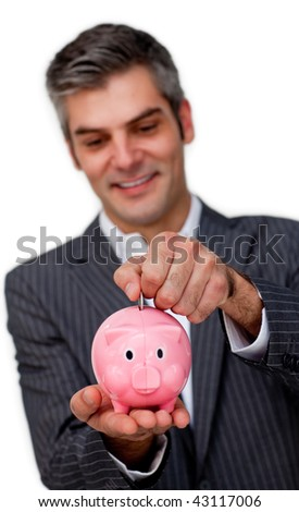 Businessman saving money in a piggybank against a white background